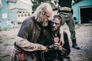 "Z NATION -- ""White Light"" Episode 202 -- Pictured: (l-r) Russell Hodgkinson as Doc, Keith Allen as Murphy -- (Photo by: Daniel Sawyer Schaefer/Go2 Z Ice/Syfy)"